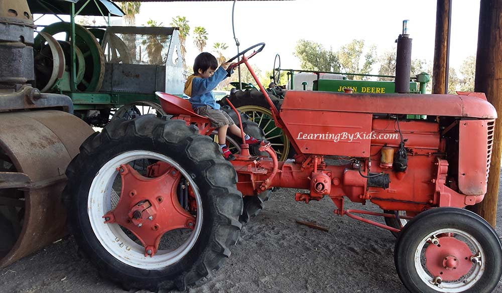 Boy and Tractor at The Antique Gas and Steam Engine Museum | LearningByKids.com